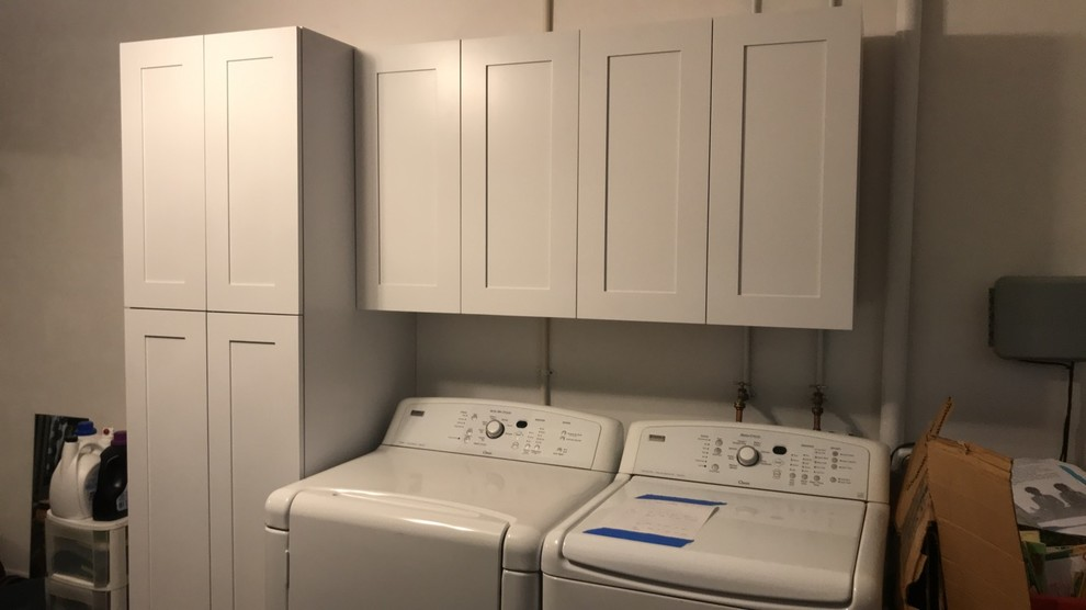 Example of a mid-sized transitional single-wall utility room design in Jacksonville with shaker cabinets, white cabinets, gray walls and a side-by-side washer/dryer