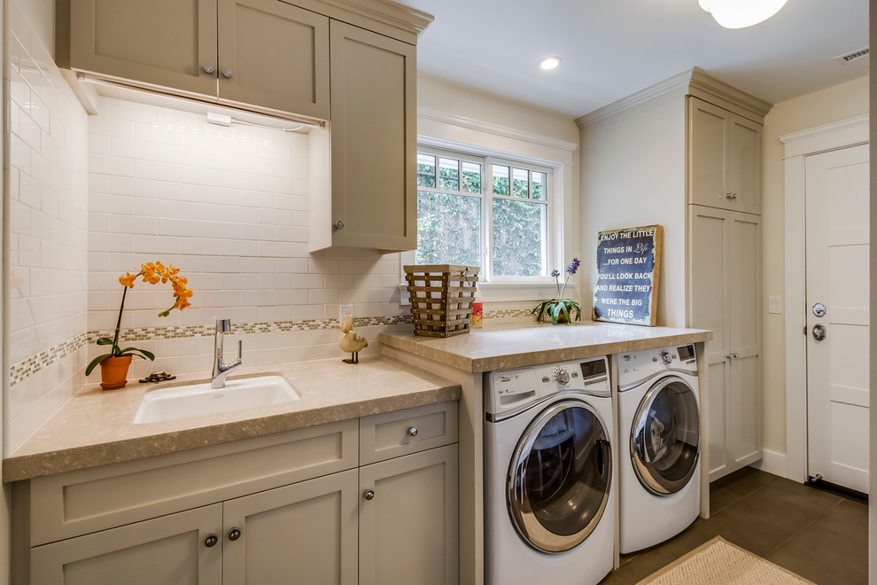 Example of a mid-sized classic gray floor dedicated laundry room design in Los Angeles with an undermount sink, shaker cabinets, gray cabinets, beige walls, a side-by-side washer/dryer and beige countertops