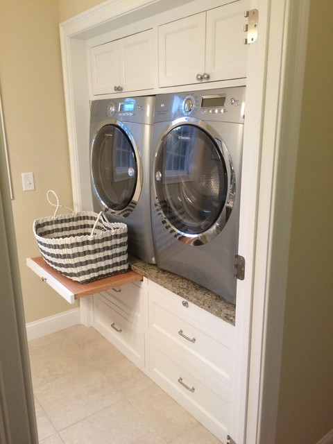 Contemporary Laundry room with raised washer dryer, white cabinets, drawer slide - Contemporary ...