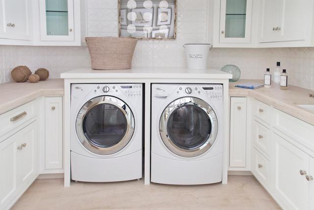 laundry closet ideas - Cozy Coastal Beach House Beach Style Laundry Room