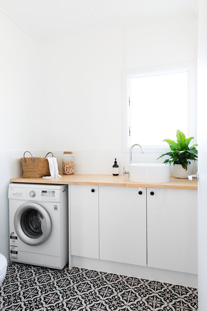 Beach style single-wall dedicated laundry room in Gold Coast - Tweed with flat-panel cabinets, white cabinets, wood benchtops, white walls, multi-coloured floor and beige benchtop.