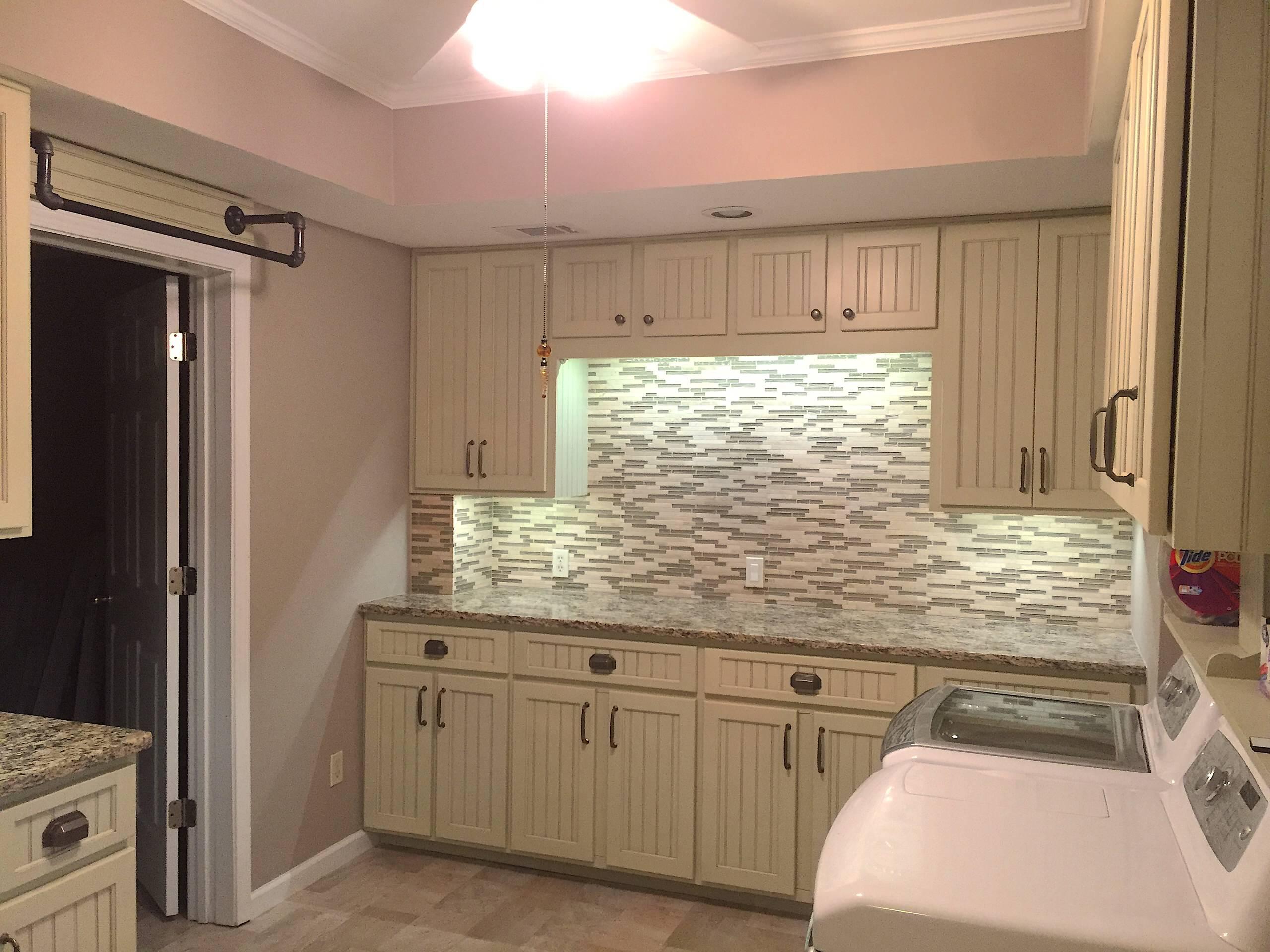 Custom built cabinets,Backsplash, counter tops