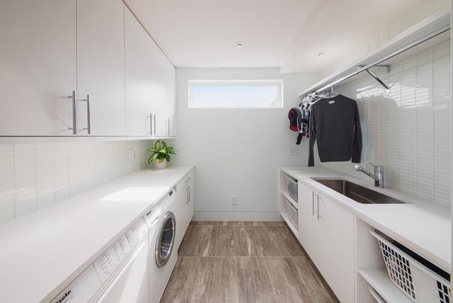 Custom Canal Condo contemporary-laundry-room