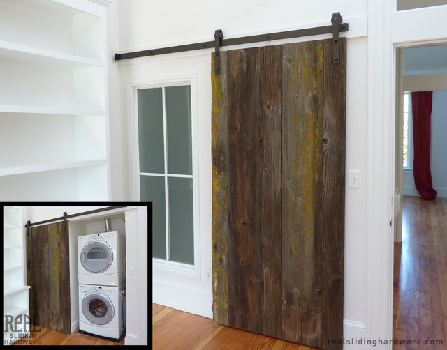 Custom rustic plank barn doors traditional laundry for Custom sliding doors