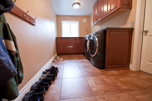 Dark Stained laundry room to match kitchen traditional-laundry-room