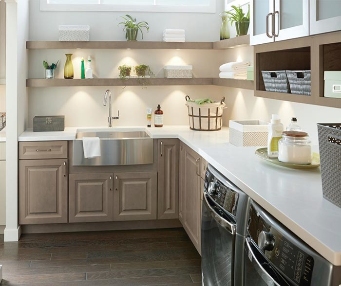 Inspiration for a mid-sized transitional u-shaped dark wood floor and brown floor utility room remodel with a farmhouse sink, raised-panel cabinets, beige cabinets, beige walls and white countertops