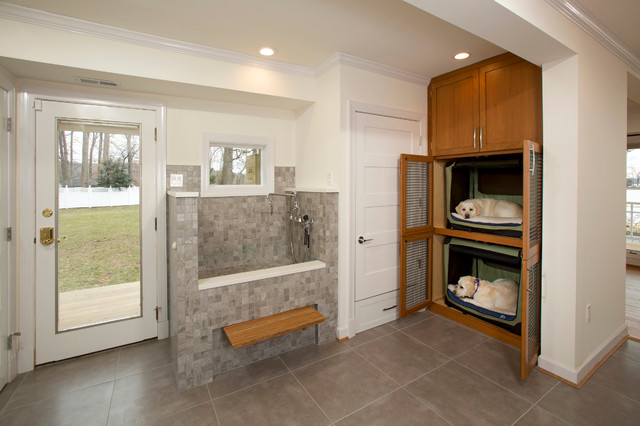 Photo of a medium sized classic l-shaped utility room in DC Metro with porcelain flooring, shaker cabinets, medium wood cabinets and white walls.