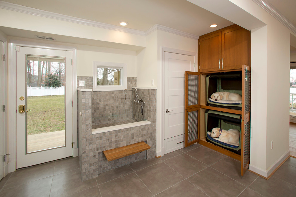 Example of a mid-sized transitional l-shaped porcelain tile utility room design in DC Metro with shaker cabinets, medium tone wood cabinets and white walls