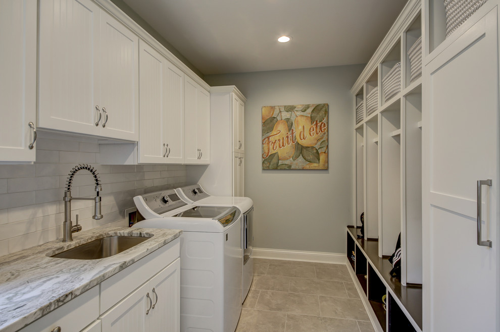 Large transitional galley porcelain floor and gray floor utility room photo in Dallas with an undermount sink, shaker cabinets, white cabinets, granite countertops, gray walls, a side-by-side washer/dryer and gray countertops
