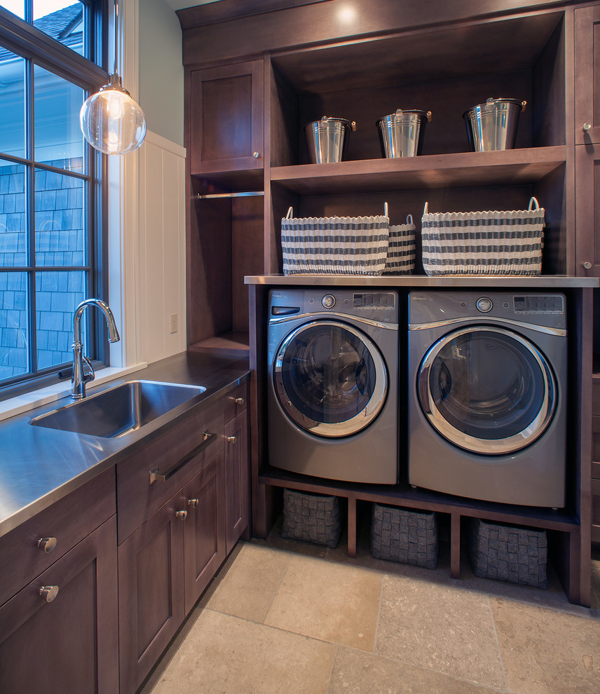 Laundry room - large transitional l-shaped ceramic floor and beige floor laundry room idea in Grand Rapids with shaker cabinets, dark wood cabinets, green walls, stainless steel countertops and gray countertops