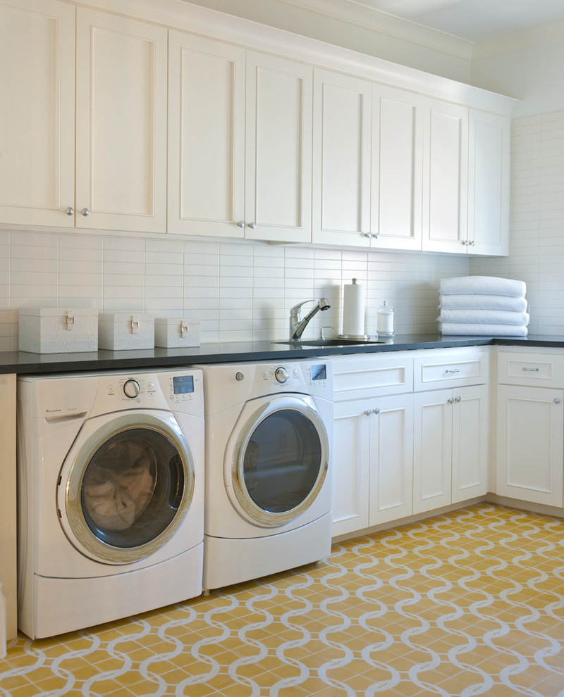Laundry room - transitional yellow floor laundry room idea in Dallas