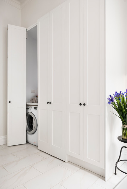 European Laundry and Linen Cupboard transitional-laundry-room
