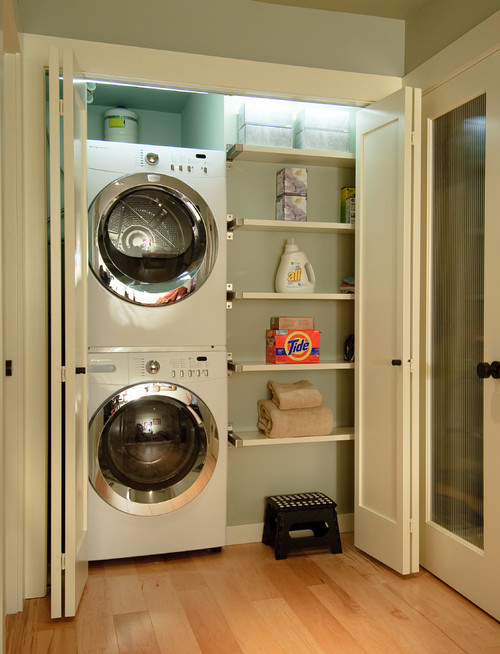 Laundry Room In Basement Or Dryer And Washing Machine On