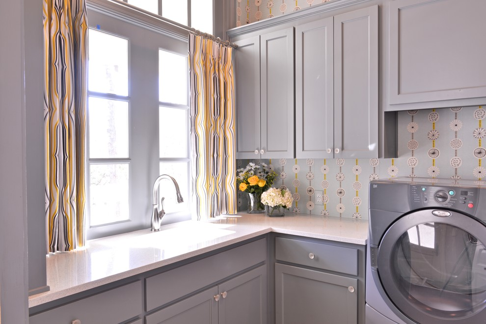 Large transitional l-shaped laundry room photo in Dallas with an undermount sink, shaker cabinets, gray cabinets, quartz countertops, blue walls and a side-by-side washer/dryer