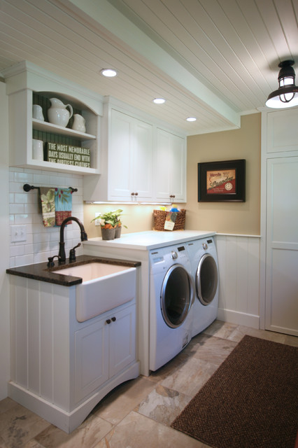 This is an example of a small farmhouse single-wall separated utility room in Other with a belfast sink, shaker cabinets, white cabinets, composite countertops, beige walls, a side by side washer and dryer and beige floors.