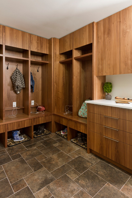 Mid-sized trendy l-shaped porcelain floor dedicated laundry room photo in Minneapolis with flat-panel cabinets, medium tone wood cabinets, quartz countertops and gray walls