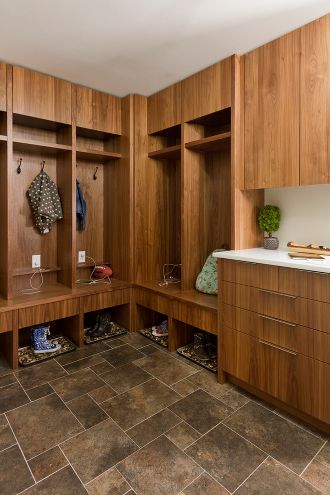 Mid-sized trendy l-shaped porcelain tile dedicated laundry room photo in Minneapolis with flat-panel cabinets, medium tone wood cabinets, quartz countertops and gray walls