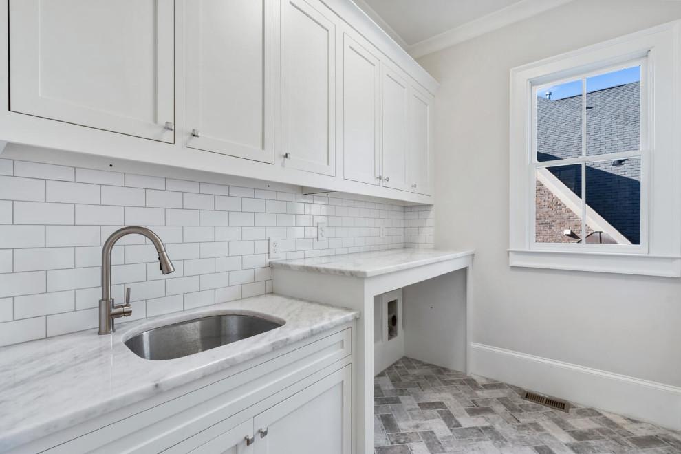 Example of a trendy laundry room design in Atlanta