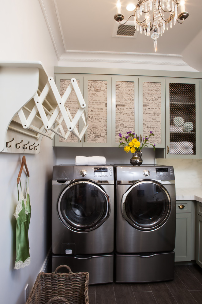 Dedicated laundry room - traditional black floor dedicated laundry room idea in San Francisco with recessed-panel cabinets
