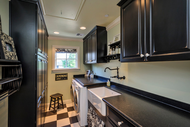 Example Of A Classic Multicolored Floor Laundry Room Design In San Francisco With Black Cabinets And