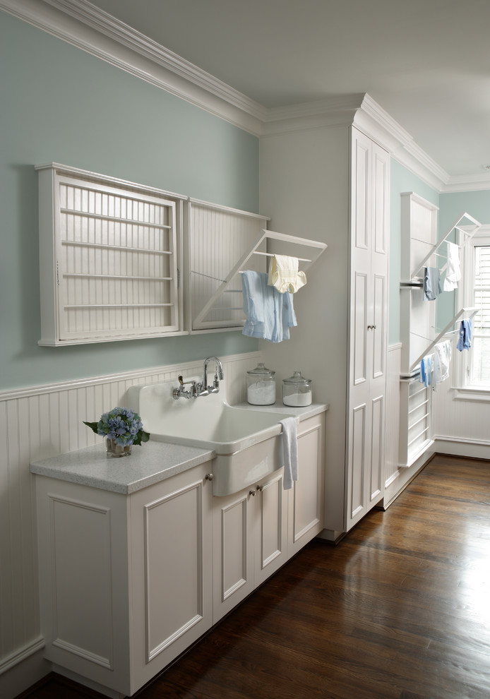 Laundry room - traditional laundry room idea in Atlanta with white cabinets, white countertops and a drop-in sink
