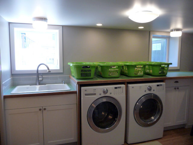 Green basement remodel ten directions design Basement laundry room remodel