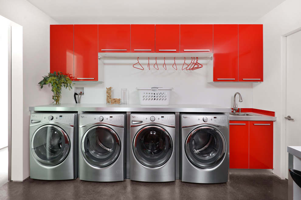 Trendy concrete floor and gray floor utility room photo in Chicago with an utility sink, red cabinets and white walls