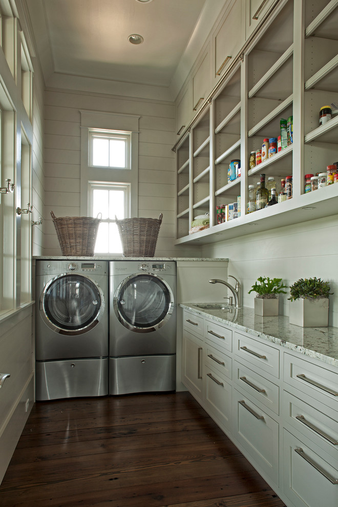 Elegant l-shaped laundry room photo in Miami with a side-by-side washer/dryer