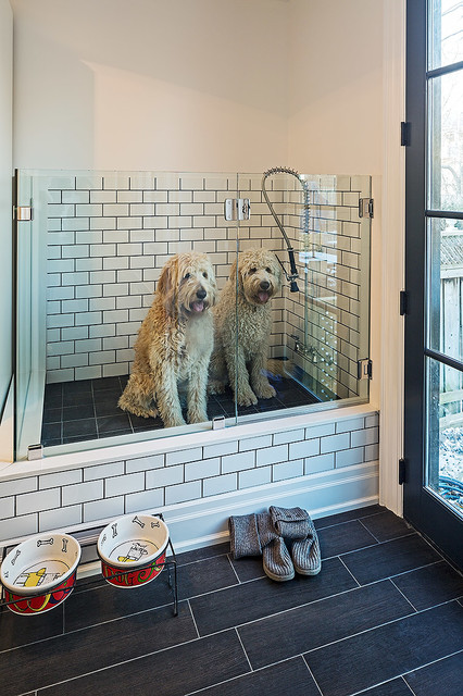 Laundry room - traditional black floor laundry room idea in Toronto with white walls