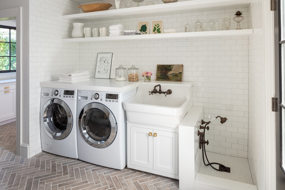 Country single-wall brick floor utility room photo in Boston with a farmhouse sink, open cabinets, white cabinets, white walls, a side-by-side washer/dryer and white countertops