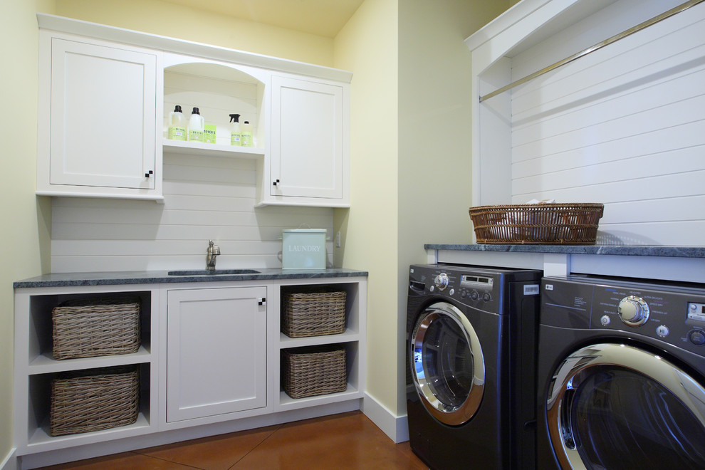 Example of a large classic l-shaped laundry room design in Grand Rapids with yellow walls, an undermount sink, white cabinets, granite countertops, a side-by-side washer/dryer and shaker cabinets