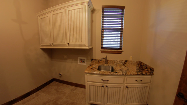 Iron Horse Ranch (Cimarron ) traditional-laundry-room