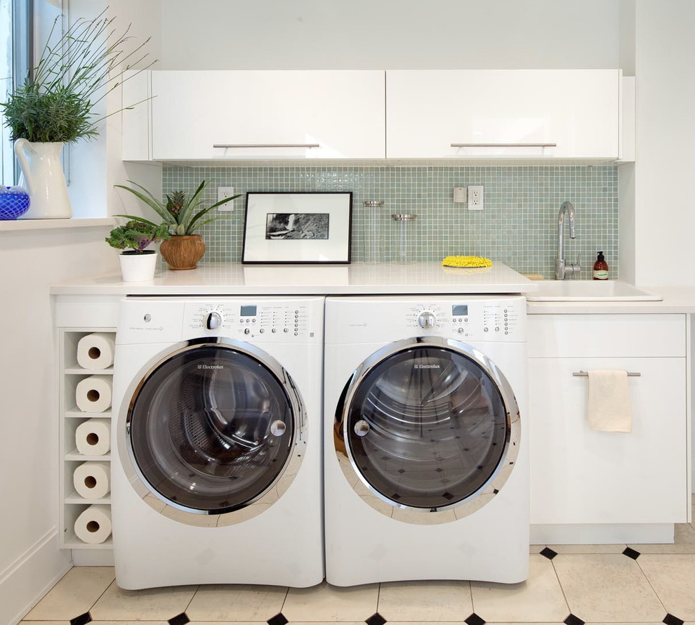 Trendy laundry room photo in New York with a drop-in sink, flat-panel cabinets, white cabinets, a side-by-side washer/dryer and white countertops