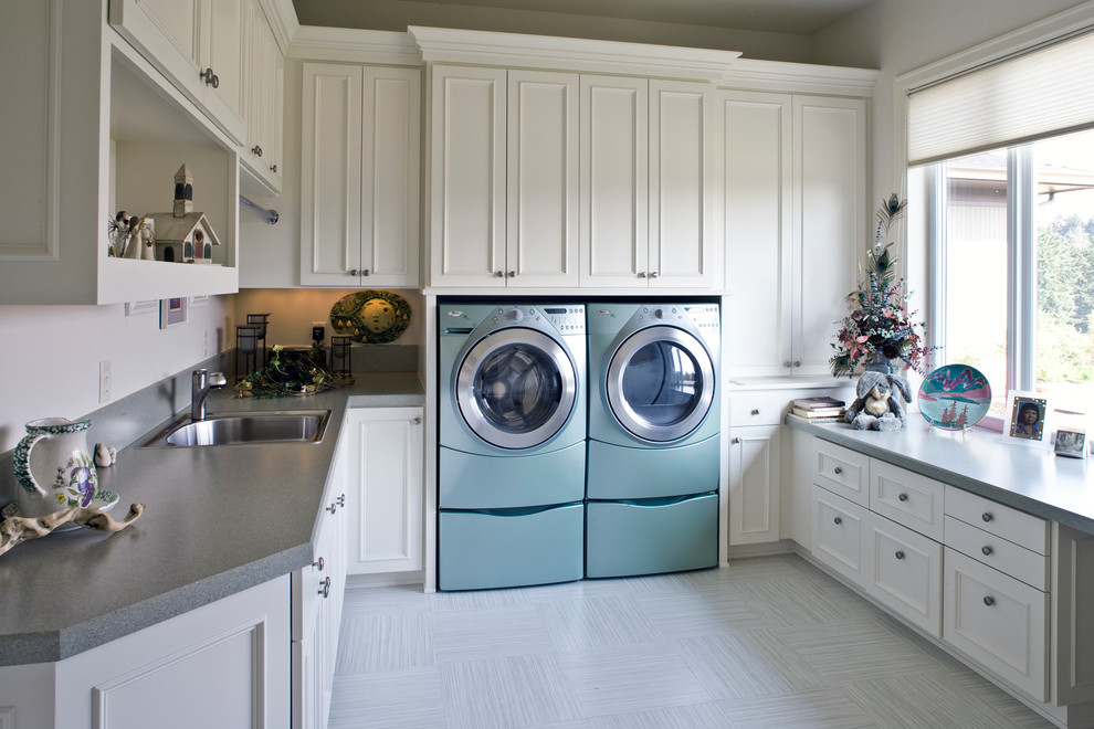 Inspiration for a timeless laundry room remodel in Portland with a drop-in sink, white cabinets, a side-by-side washer/dryer and gray countertops