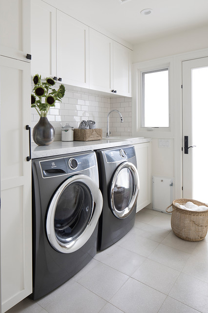 Inspiration for a small transitional single-wall ceramic floor and beige floor dedicated laundry room remodel in San Francisco with a drop-in sink, shaker cabinets, white cabinets, marble countertops, white walls, a side-by-side washer/dryer and white countertops