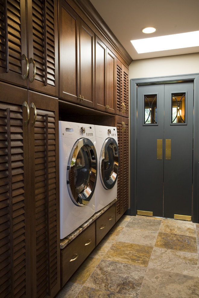 Elegant laundry room photo in Other with a side-by-side washer/dryer