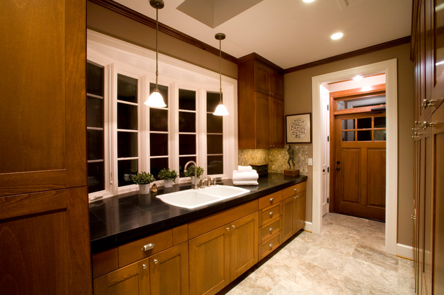 bowed window and silver travertine flooring traditional-laundry-room