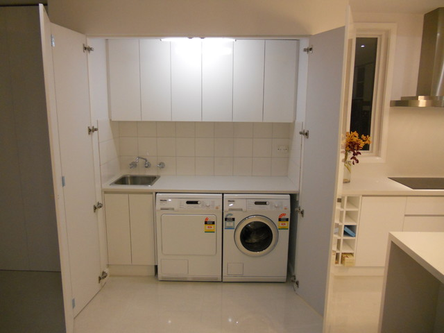 hidden closet door ideas - Laundries Contemporary Laundry Room melbourne by