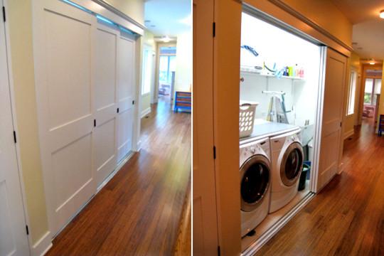 Laundry center contemporary laundry room chicago for Laundry room sliding doors