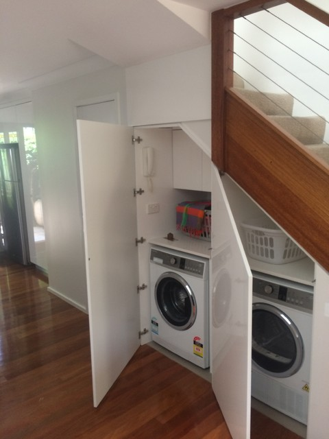 Laundry moved to utilise space under stairs for Room design under stairs