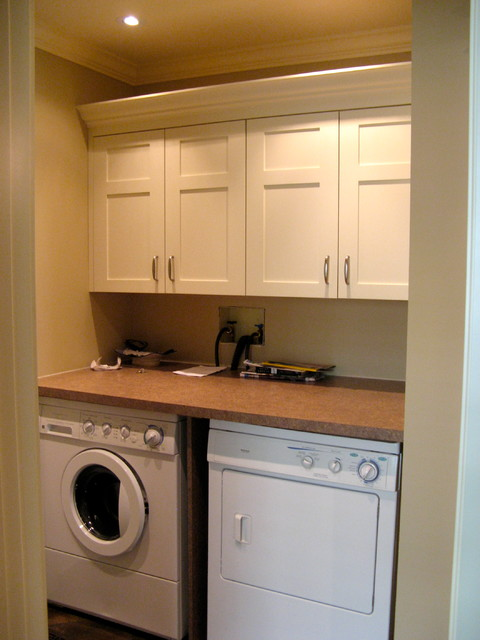 Small Traditional Galley Utility Room In Calgary With Shaker Cabinets White Laminate Benchtops