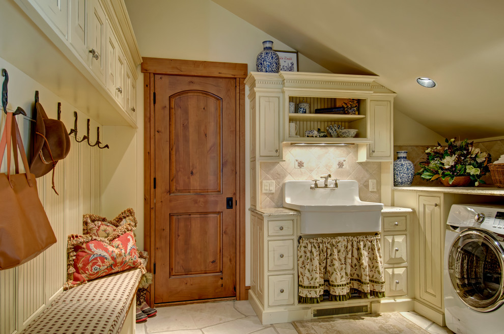 Example of a farmhouse laundry room design in Denver with a farmhouse sink, beige cabinets, beige walls and beaded inset cabinets