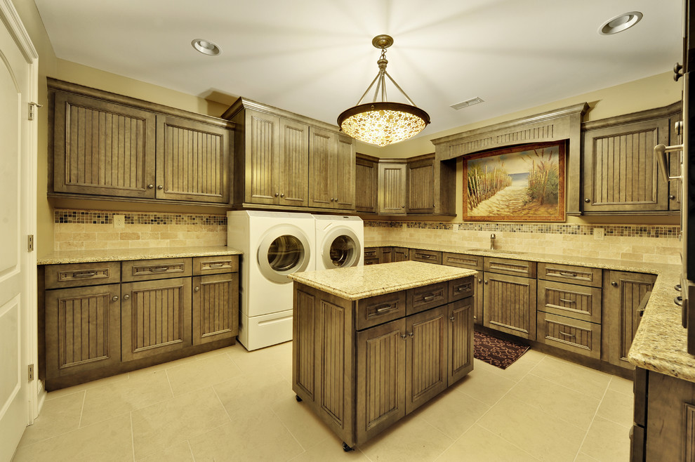 Elegant laundry room photo in Philadelphia with dark wood cabinets and a side-by-side washer/dryer