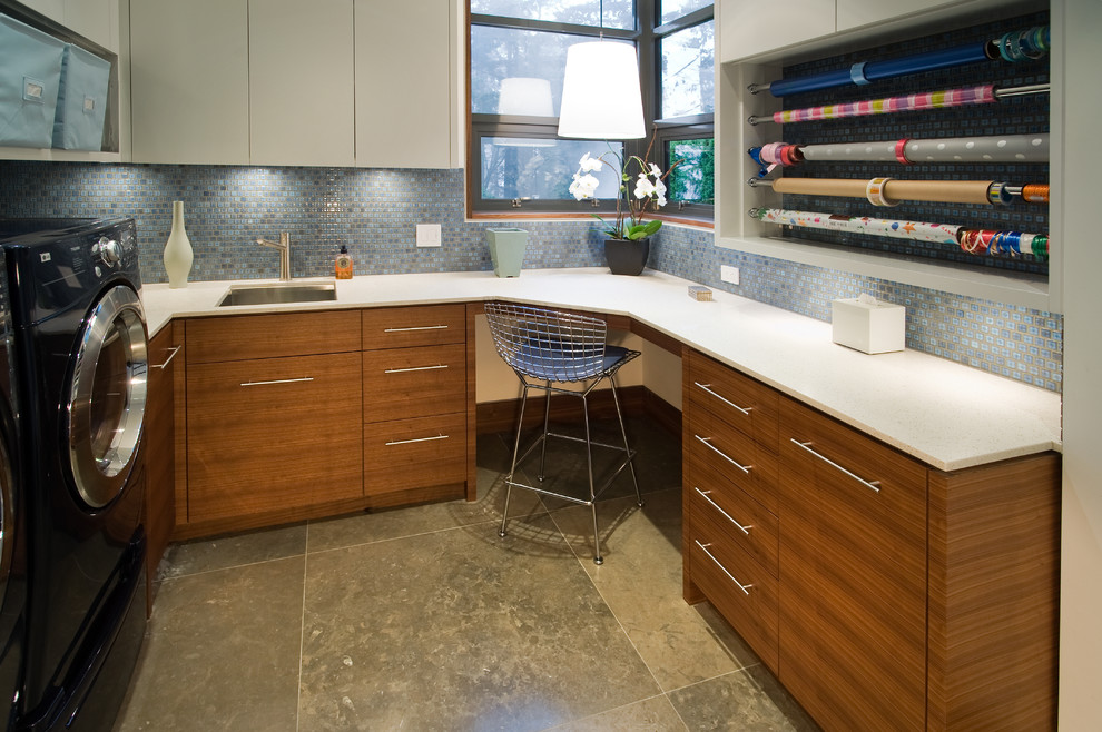 Laundry room - contemporary gray floor laundry room idea in Vancouver with medium tone wood cabinets and white countertops