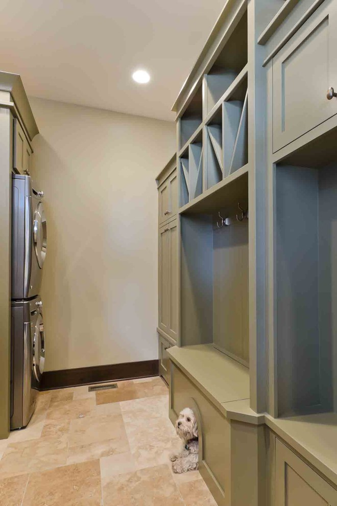 Inspiration for a mid-sized transitional galley porcelain floor and beige floor utility room remodel in Tampa with open cabinets, gray cabinets, beige walls and a stacked washer/dryer