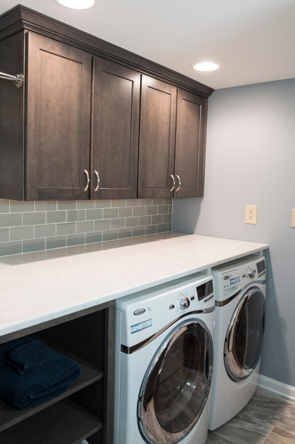 Laundry Room With Quartz Countertop And Glass Subway Tile