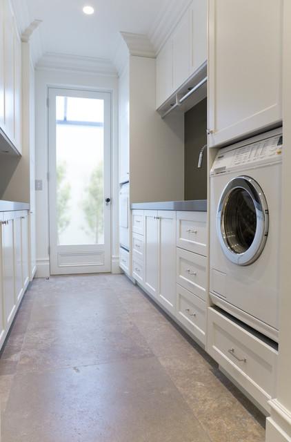 Laundry room with wine storage