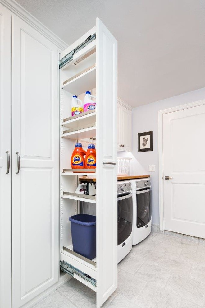Elegant laundry room photo in San Francisco with raised-panel cabinets, white cabinets, gray walls and a side-by-side washer/dryer