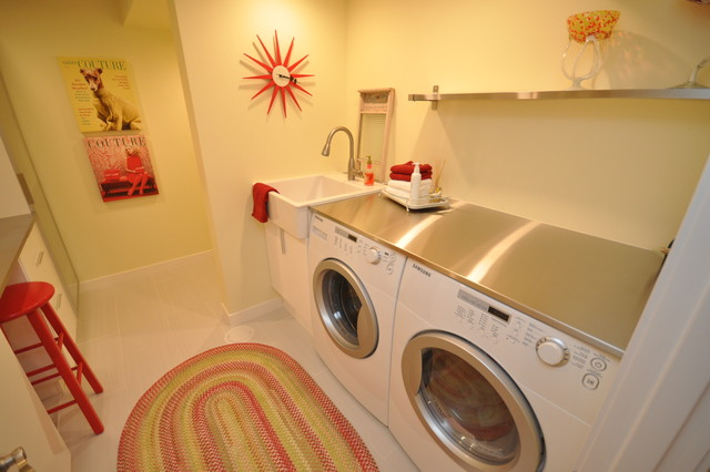 modern laundry room by The Design Den Homes Inc.