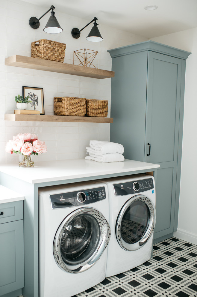 Example of a farmhouse single-wall multicolored floor dedicated laundry room design in Detroit with shaker cabinets, blue cabinets, white walls, a side-by-side washer/dryer and white countertops